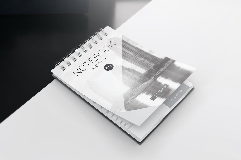 A6螺旋笔记本样机模板展示A6 Spiral Notebook Mockups